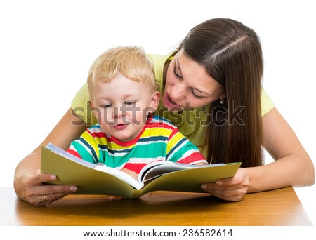 happy mother reading a book to kid boy