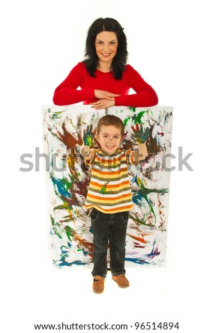 Happy mother resting hands on mini painted wall  while her son showing messy painted palms isolated onw hite background - stock photo