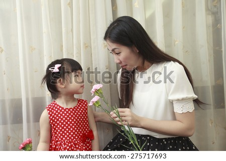 Happy Mother's Day. Child send gift to mother.