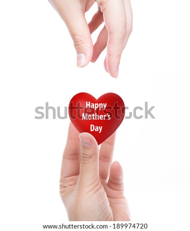 Happy mother's day  Red heart in woman hand - stock photo