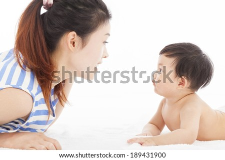 Happy  mother talking with  baby boy - stock photo