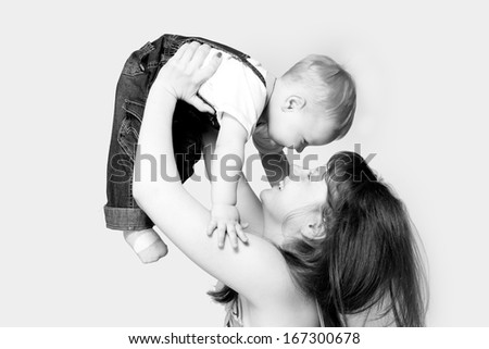 Happy mother with a child on a white background - stock photo