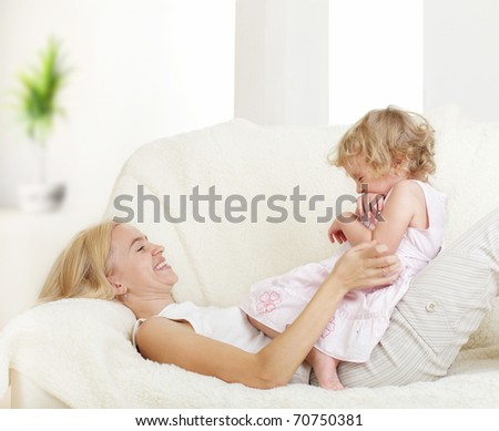 Happy mother with a daughter at home - stock photo