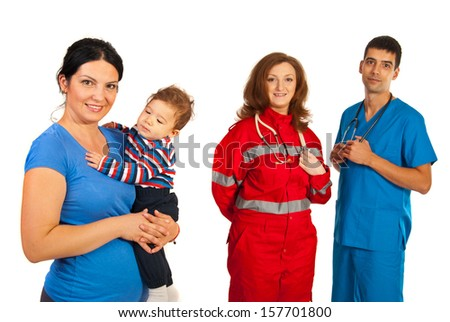Happy mother with baby in front of team of different doctors isolated on white background - stock photo