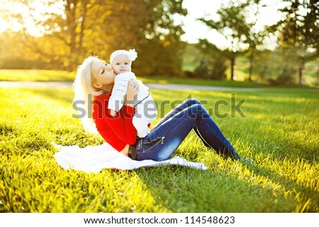 Happy mother with child in autumn day