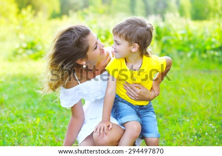 Happy mother with child son together outdoors in summer day - stock photo