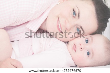Happy Mother with her Baby. - stock photo