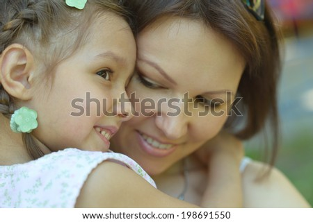 Happy mother with her daughter walk in summer