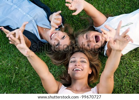 Happy mother with her daughters in park outdoors