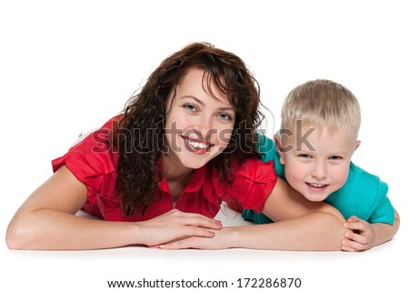 Happy mother with her son lie on the floor on the white background