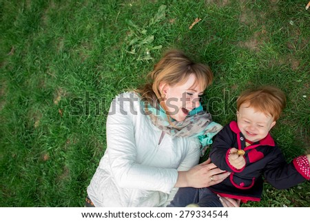 happy mother with little baby - stock photo
