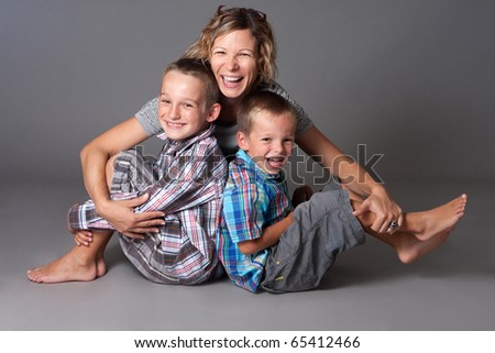 happy mother with two boys - stock photo