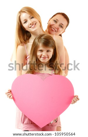 happy mother with two daughters holding big heart, isolated on white background - stock photo