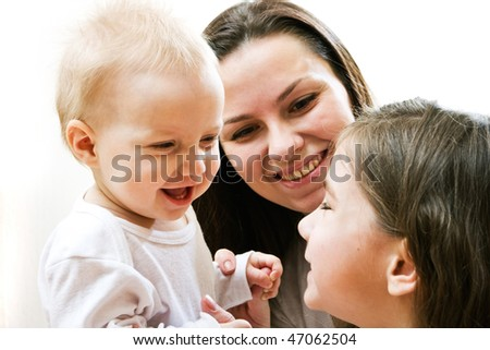 Happy mother with two daughters on white background