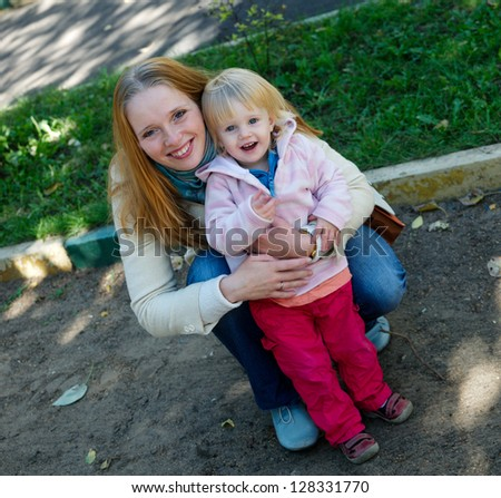 Happy mother with 1 year old baby girl - stock photo