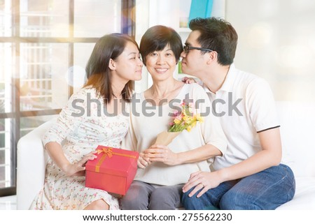 Happy mothers day. Asian boy and girl kissing mother. Family living lifestyle at home. - stock photo