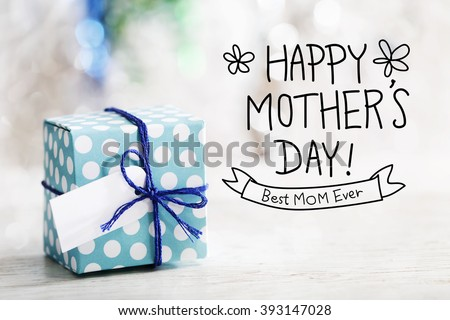 Happy Mothers Day message with small handmade gift box  - stock photo