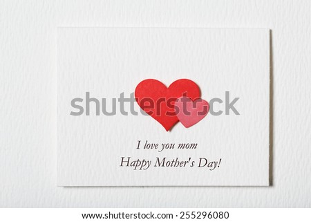 Happy Mothers Day white message card with hand made hearts - stock photo