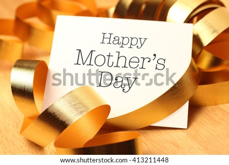 Happy mothers day with gold decoration. Mother's Day is observed the second Sunday in May. - stock photo
