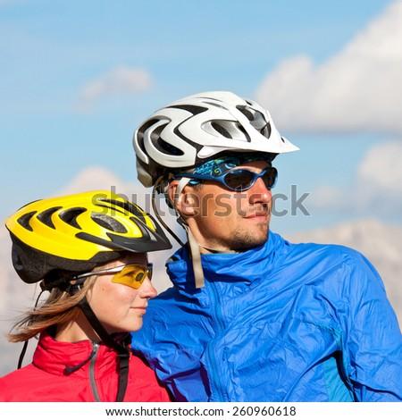 Happy mountain biking couple healthy lifestyle fun concept - stock photo