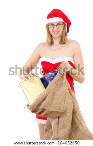Happy Mrs. Claus taking gifts out of her jute bag