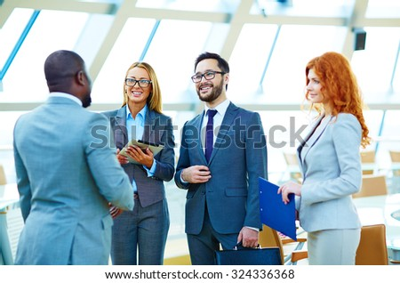 Happy multi-ethnic business people having consultation - stock photo
