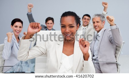 Happy multi-ethnic business team celebrating a sucess in the office