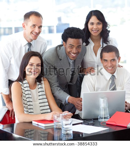 Happy multi-ethnic business team working together in office - stock photo