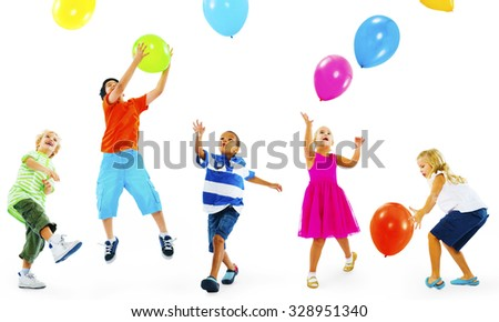 Happy Multi-Ethnic Children Playing Balloons Together - stock photo