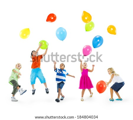 Happy Multi-Ethnic Children Playing With Balloons - stock photo