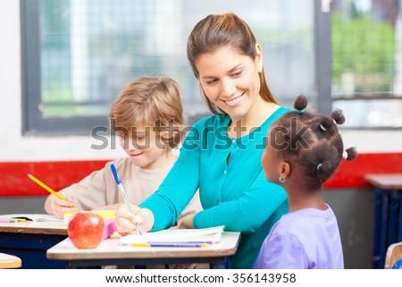 Happy multi ethnic classroom in elementary school. - stock photo