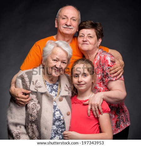 Happy multi-generation family on a gray background