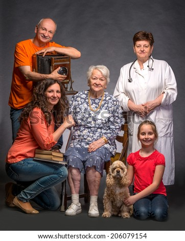 Happy multi-generation family on a gray background - stock photo