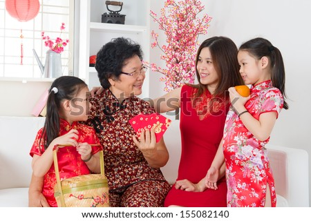 Happy multi generations Asian family celebrate Chinese new year at home. - stock photo
