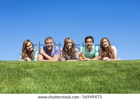 Happy, Multi-racial group of Young Adults outdoors