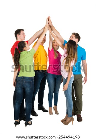 Happy Multiethnic Friends High Five For Their Teamwork Over White Background - stock photo