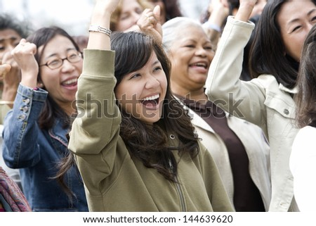 Happy multiethnic group of women in a rally - stock photo