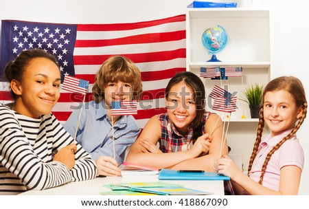 Happy multiethnic students at the geography lesson - stock photo