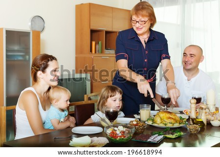 happy multigeneration family communicate over holiday table