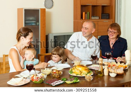 Happy multigeneration family having holiday dinner at home together