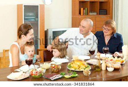 Happy multigeneration family having holiday dinner at home together - stock photo