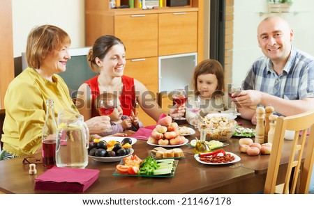 happy multigeneration family together around festive table at home