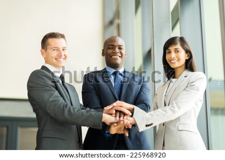 happy multiracial business team putting hands together - stock photo