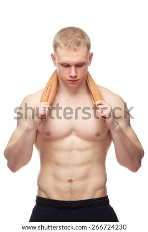 Happy muscular guy with towel over white background. - stock photo