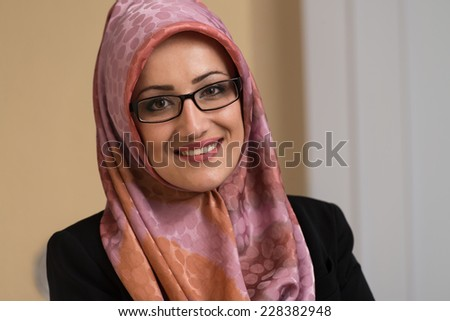 Happy Muslim Businesswoman In The Office - stock photo