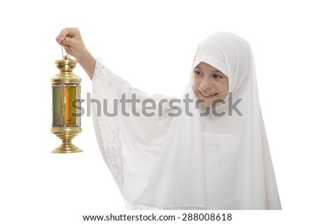Happy Muslim Girl Celebrating Ramadan with Festive Lantern Isolated on White Background - stock photo