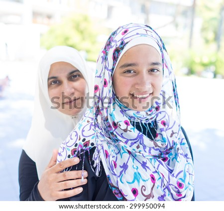 Happy Muslim girls - stock photo