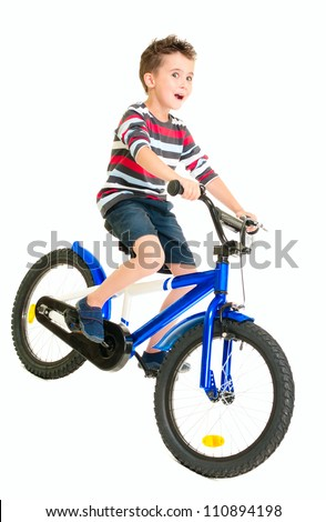 Happy naughty little boy riding bike isolated on white