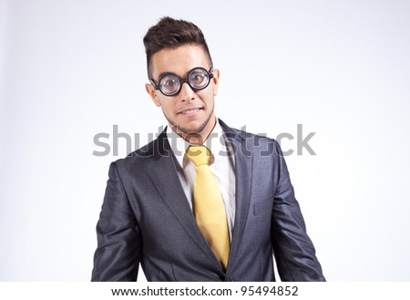 HAppy nerd businessman with funny glasses - stock photo