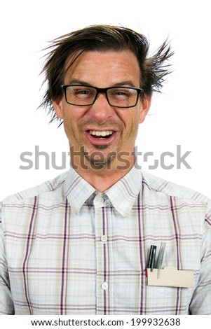 Happy nerdy looking man smiles with a silly expression and poses. - stock photo